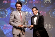 Mr.Kay Kay Menon receiving the title of 'Power Brands India Industry Trendsetter_